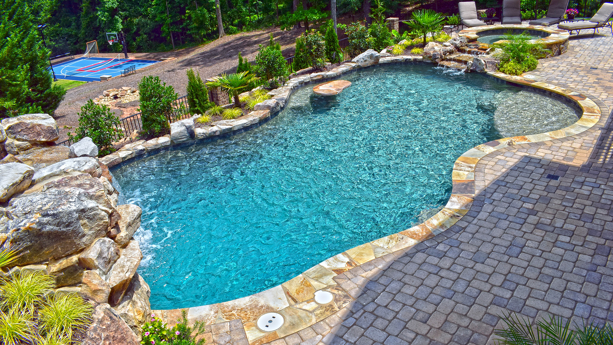 Rustic Paradise | Aqua Design Pools & Spas, LLC.