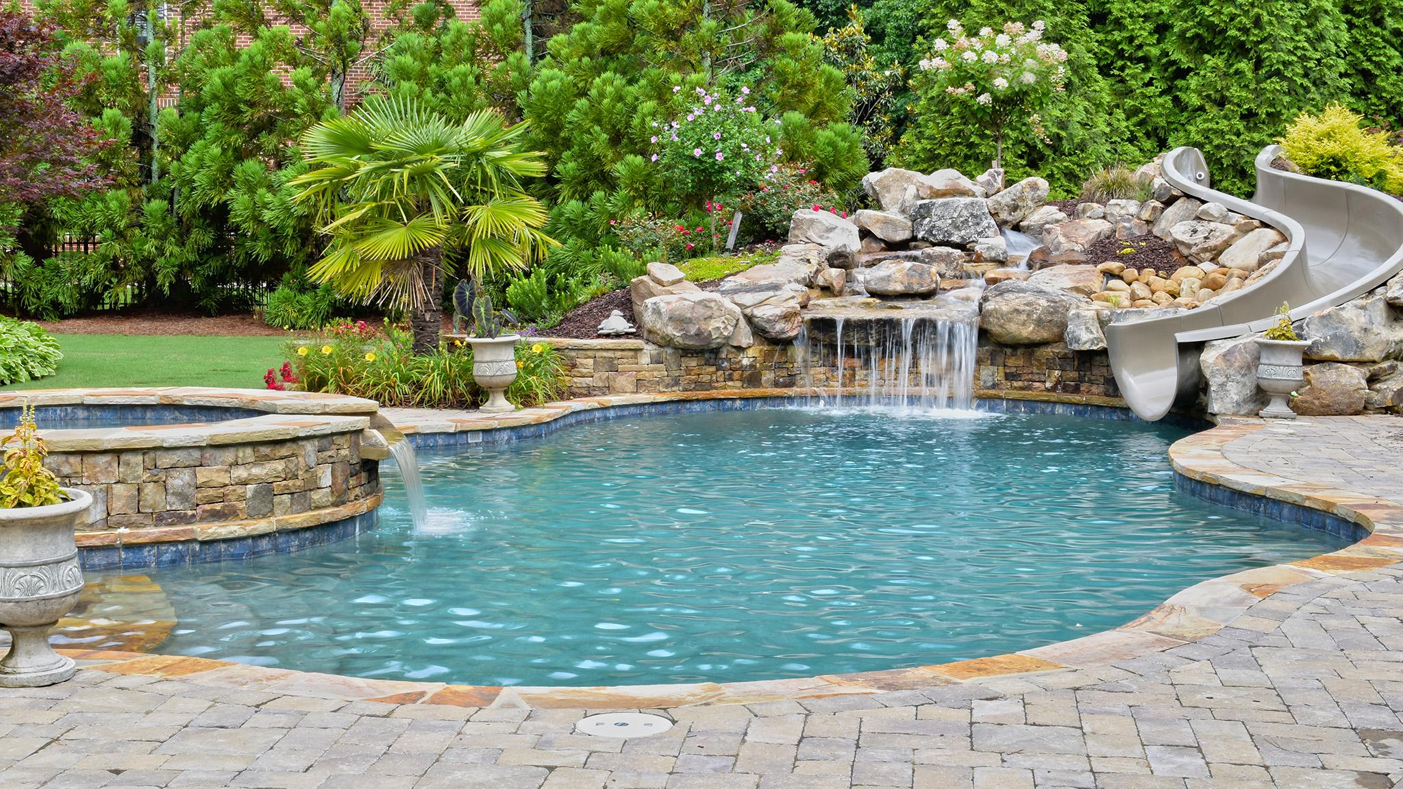 Slides | Aqua Design Pools & Spas, LLC.